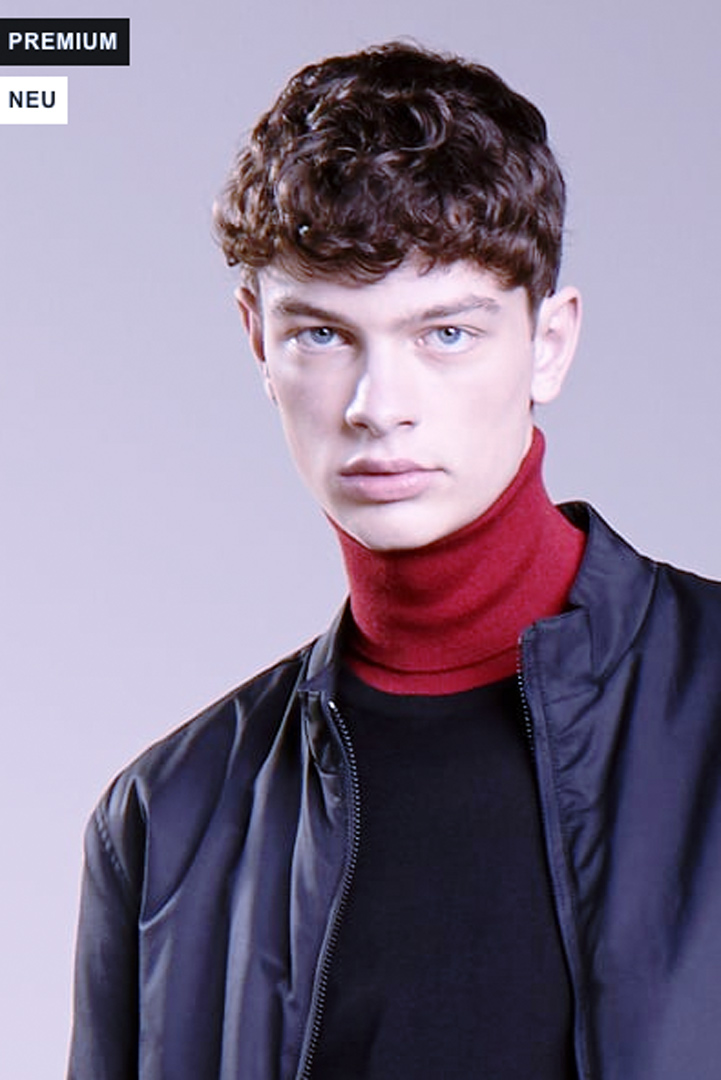 man with red turtleneck