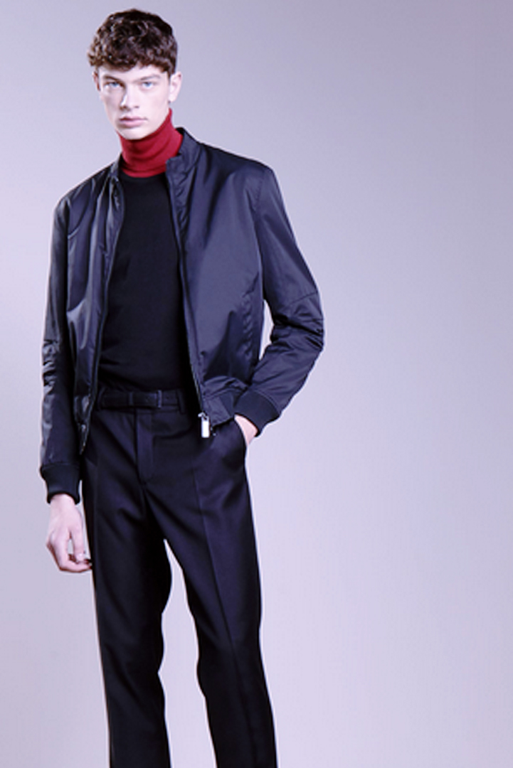 man in black with red turtleneck