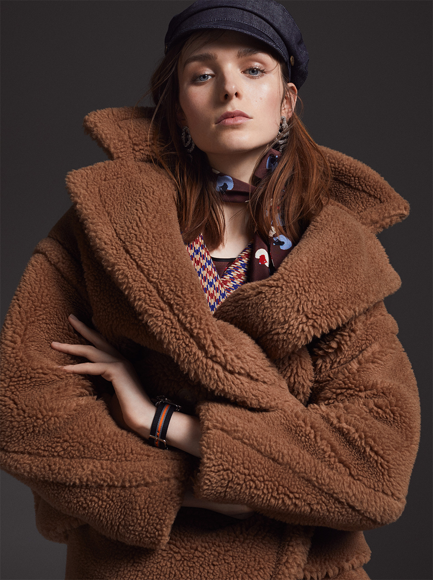 female model brown jacket brown hair