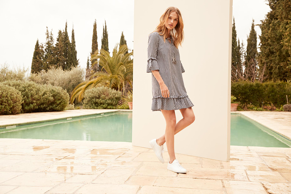 swimming pool female model white wall shoes grey dress