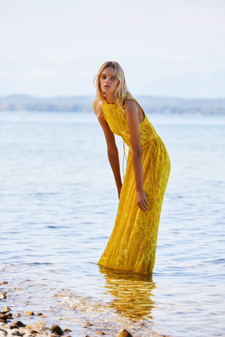 model yellow dress water