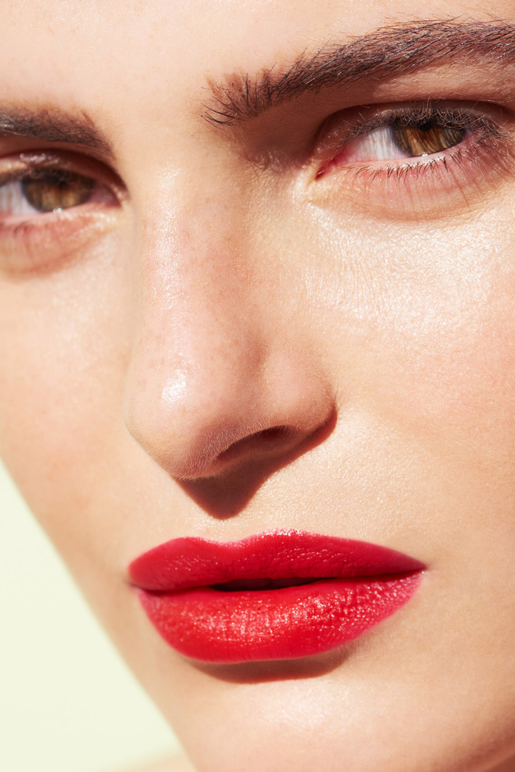 woman face red lipstick