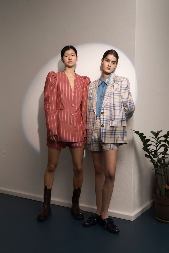 two girls in plaid suits