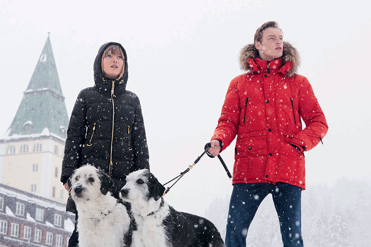 couple with dogs in snow