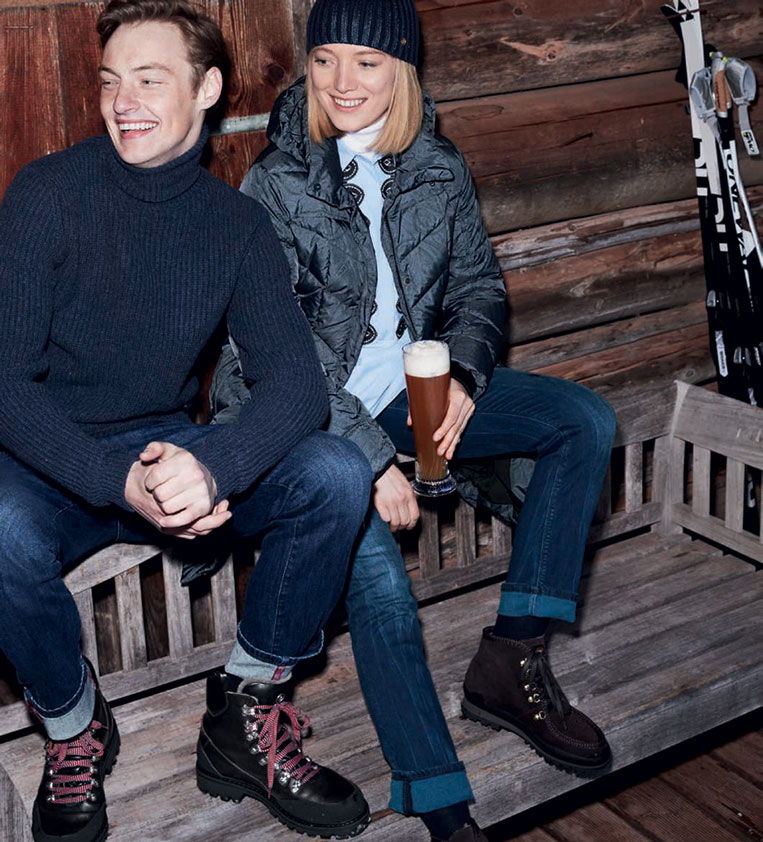 couple sitting on bench indoor in winter