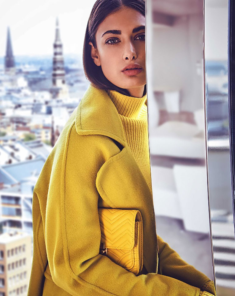 female model in yellow