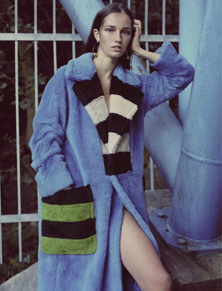 Model Posing In Blue Fur Coat