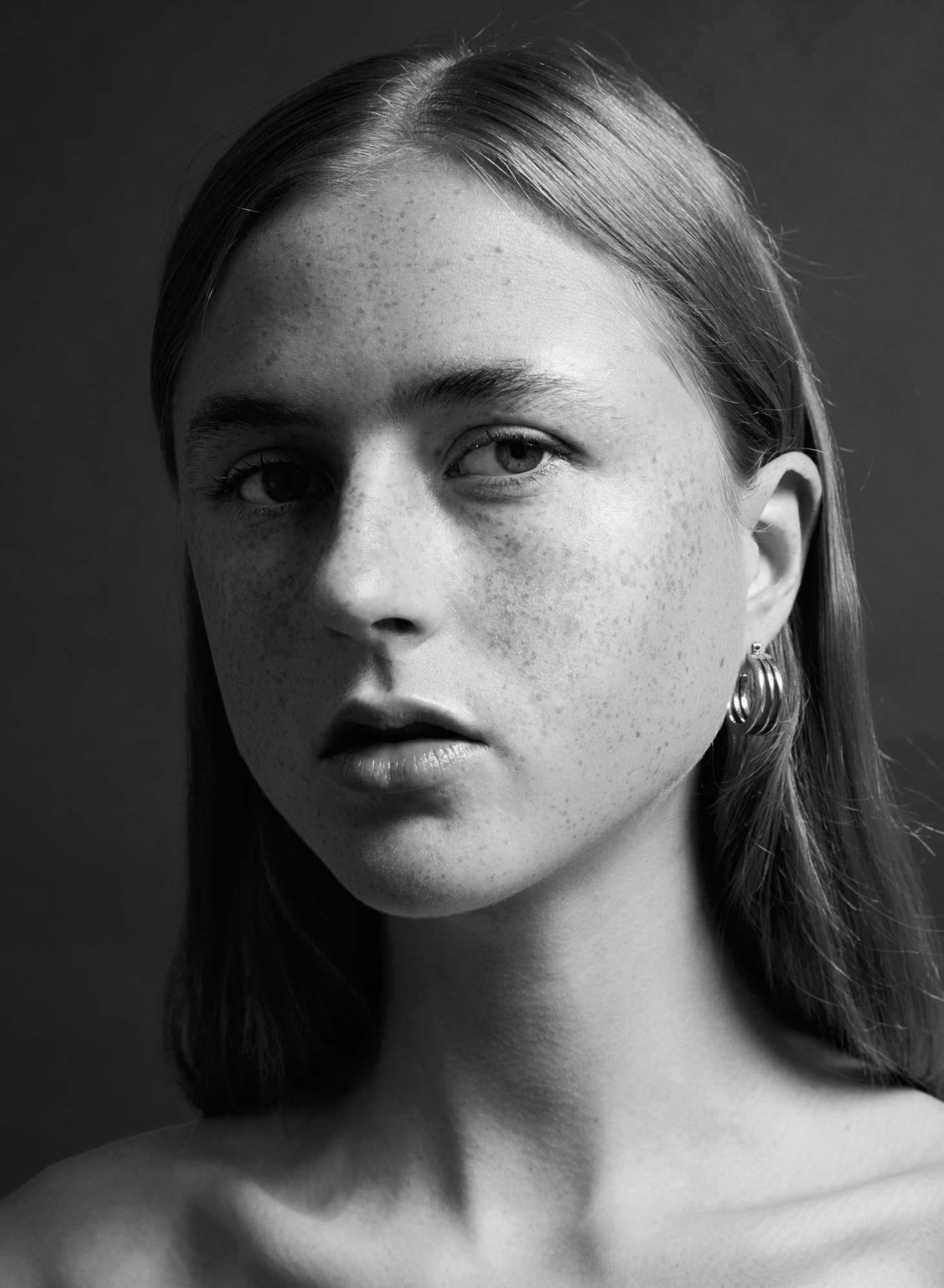 black and white young girl freckles blonde hair
