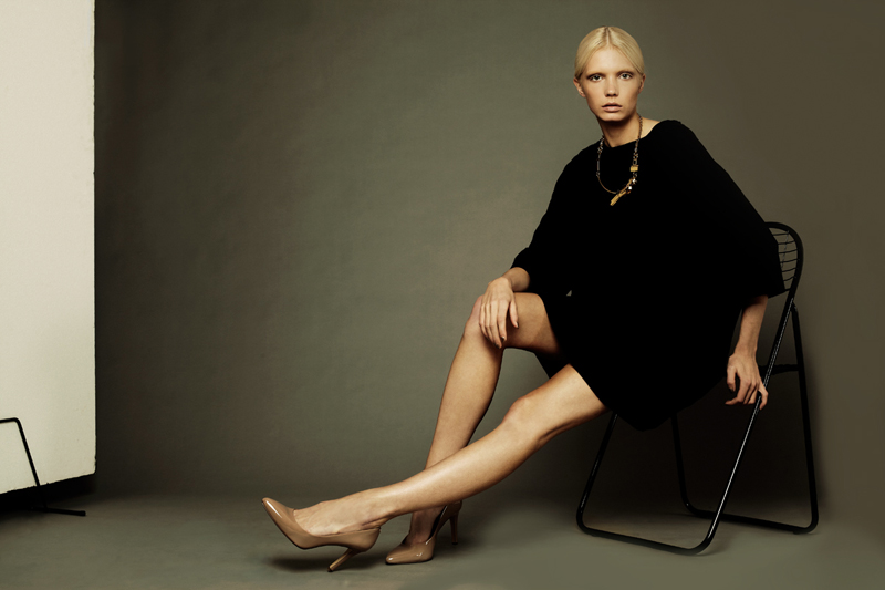 Blond Model Sitting on Chair Pose