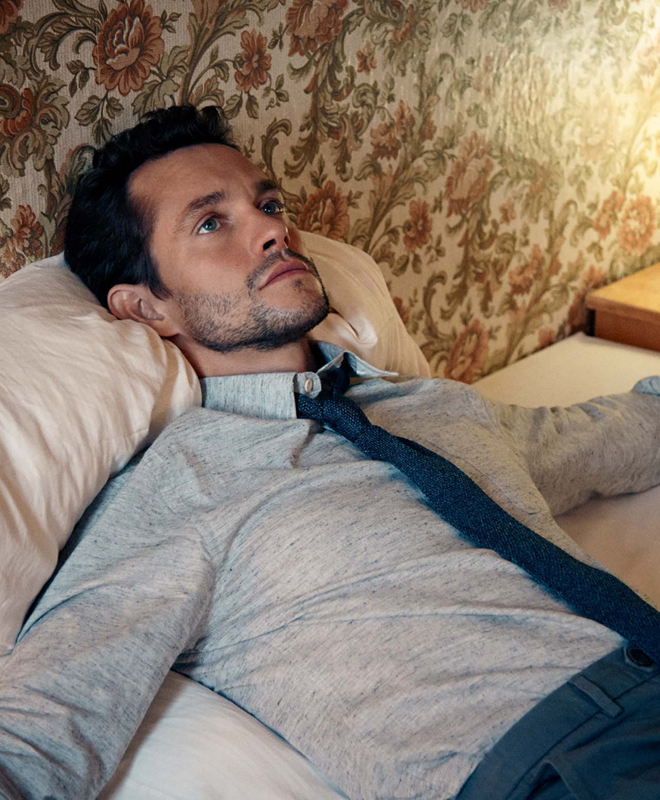 The Article Magazine (UK) Hugh Dancy Laying on Bed