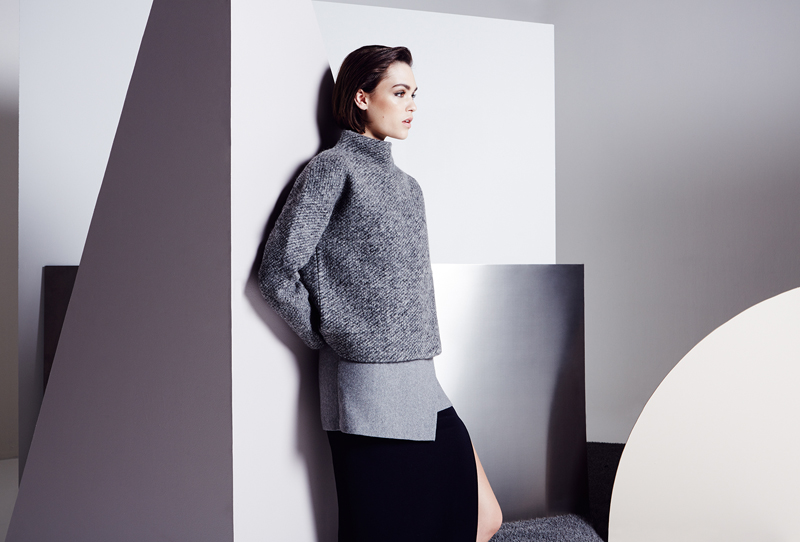 Model Posing Leaning Grey Outfit Minimal