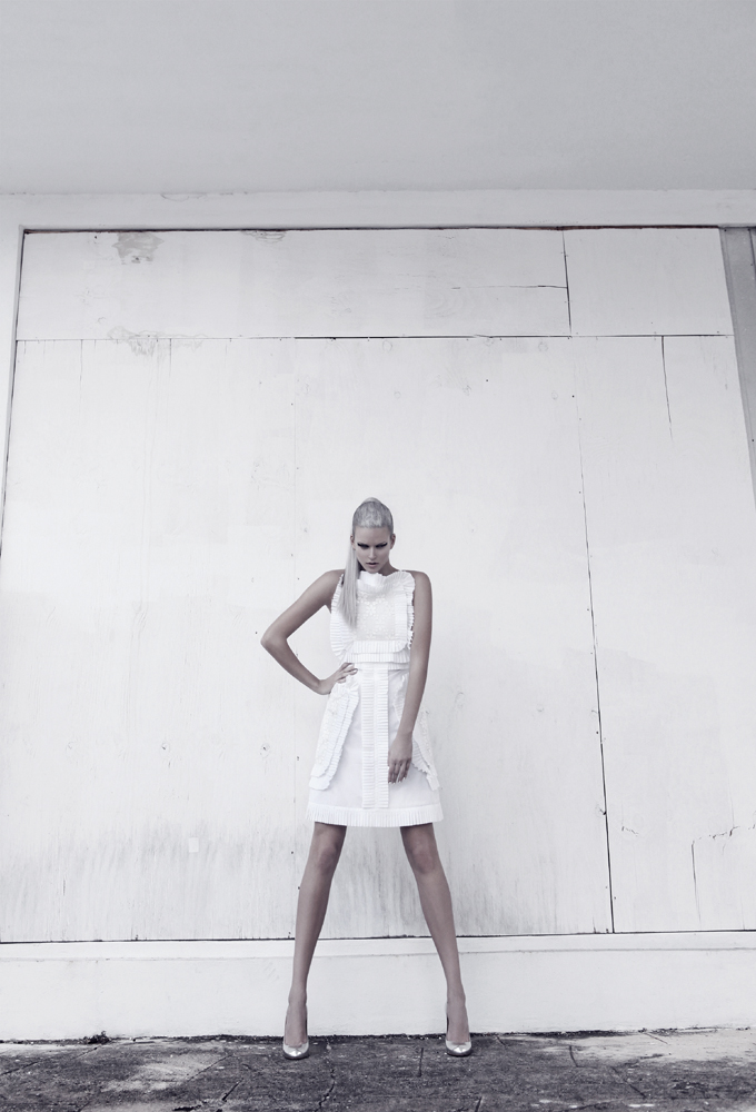model posing wall white dress silver hair straight ponytail