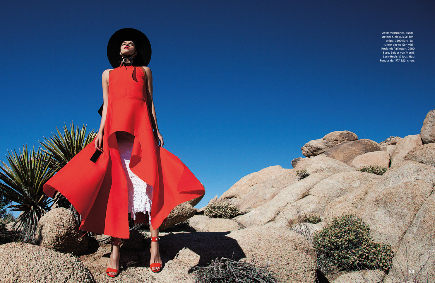 high fashion dress hat highheels rocks posing desert