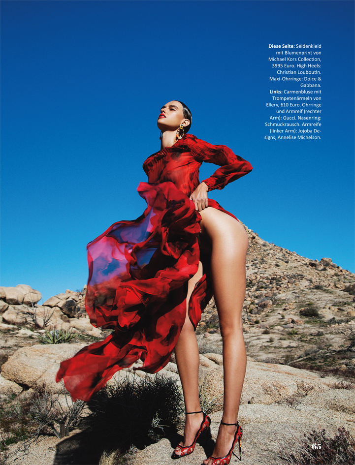red dress high fashion editorial model posing rocks desert style