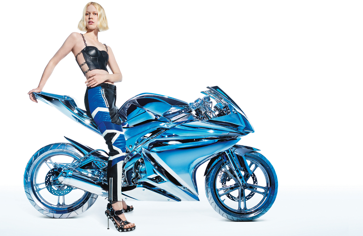 Blond Female Model Leatherjacket sitting on Chrome Motorcycle