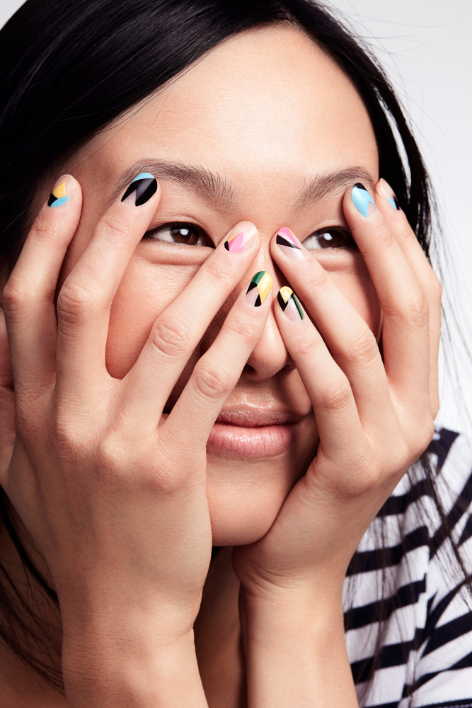 Asian Female Model With Nail Polish