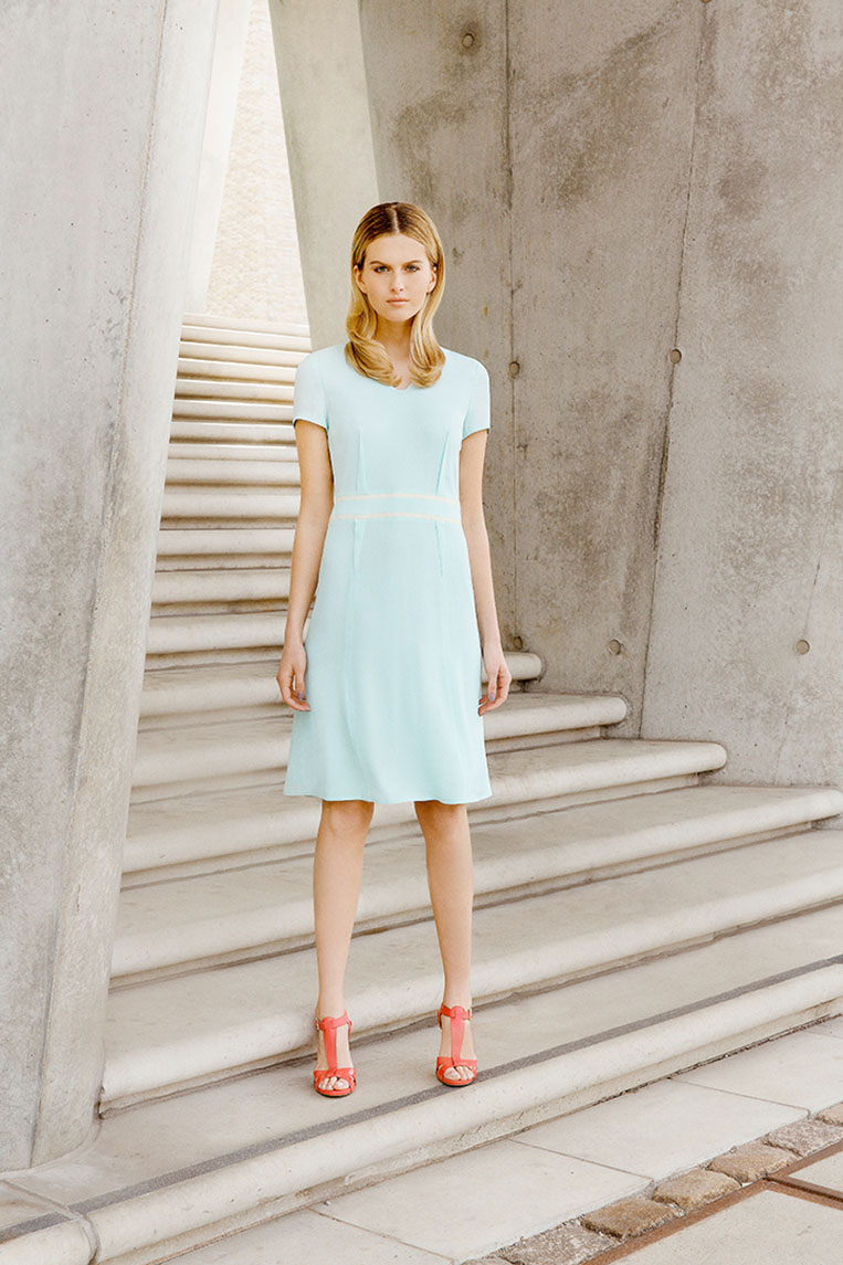 concrete wall blue dress  blond hair stairs
