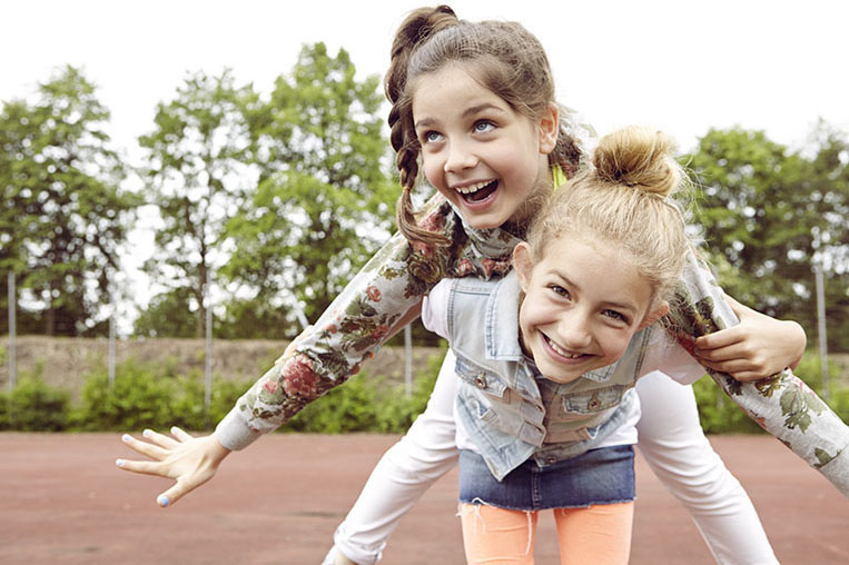 funny kids jumping girls