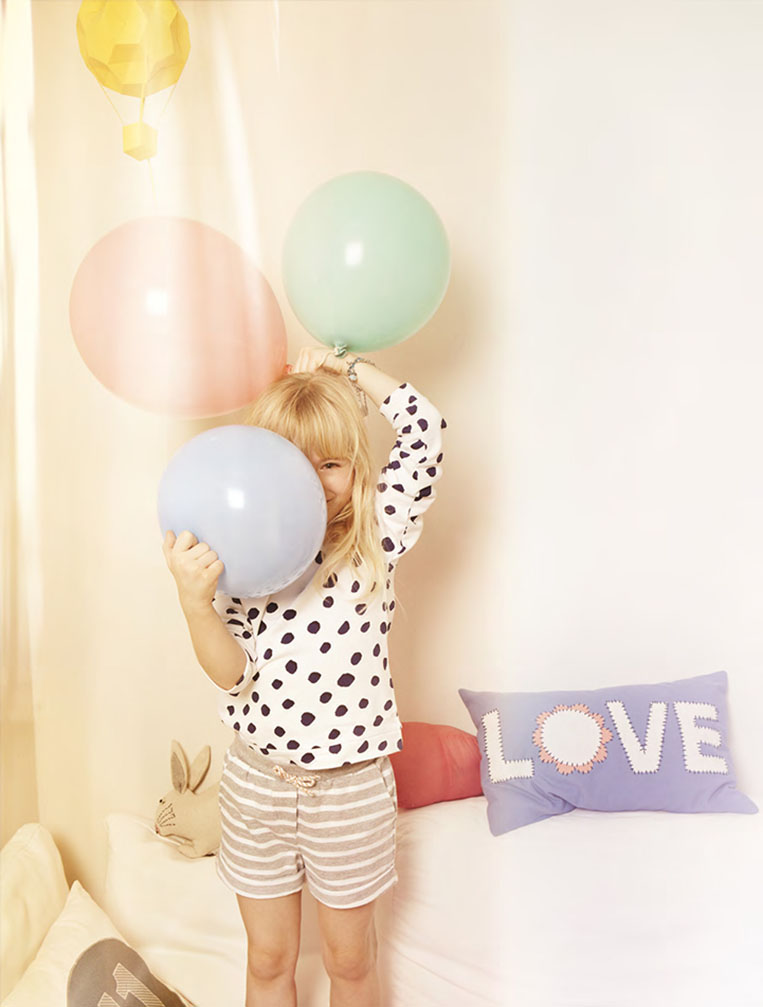 balloon green blue red blond child