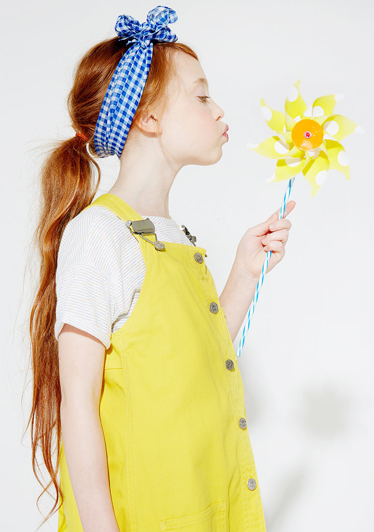 blow girl yellow dungarees blue red hair