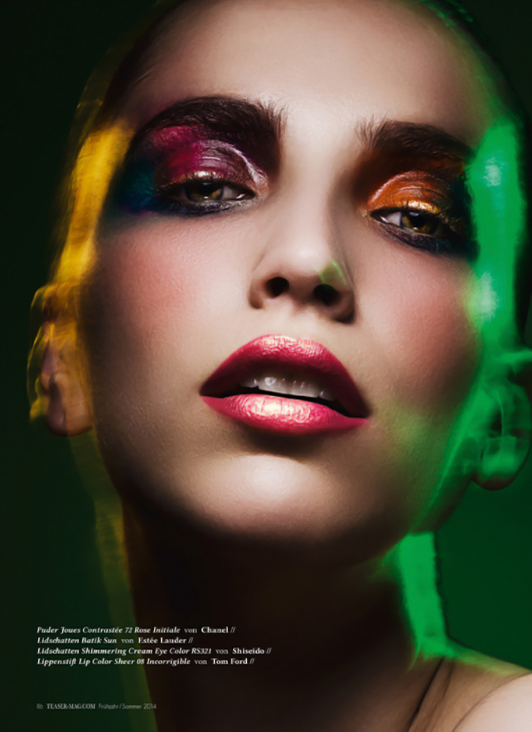 young female model face in heavy makeup