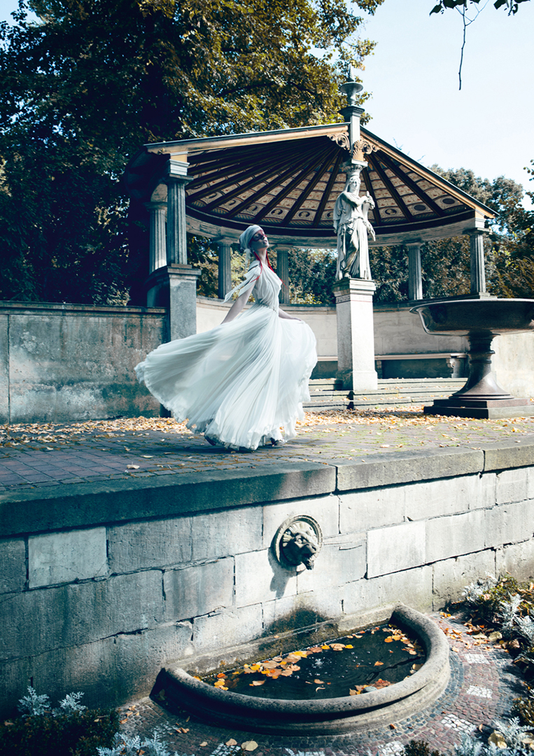 young female model in wedding dress outdoor