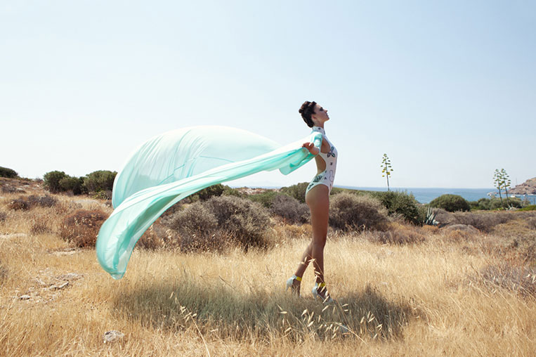young female model wearing silk clothes outdoor