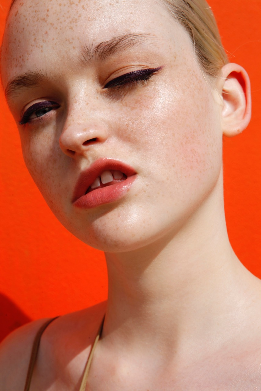 beauty freckles orange background girl lips
