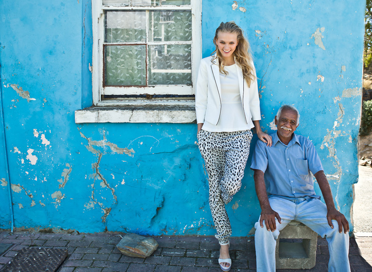 blond girl old man blue wall