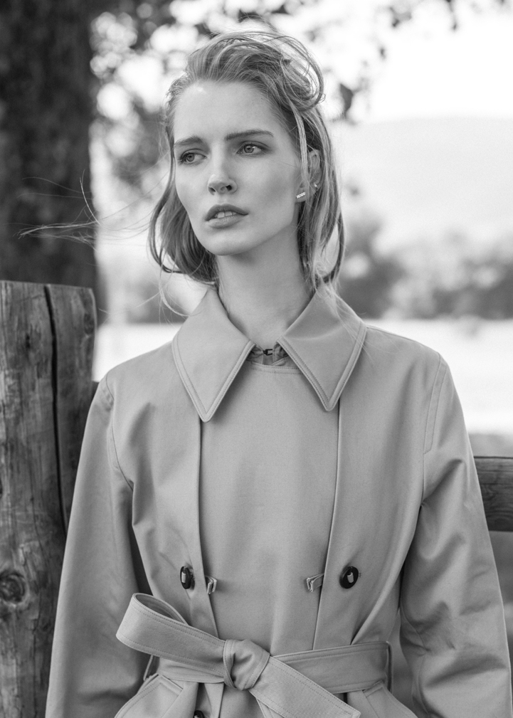 girl blond bw trenchcoat nature