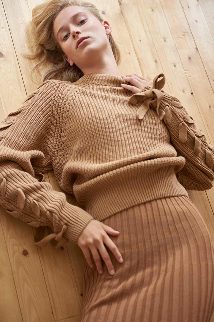 blond pullover wooden floor