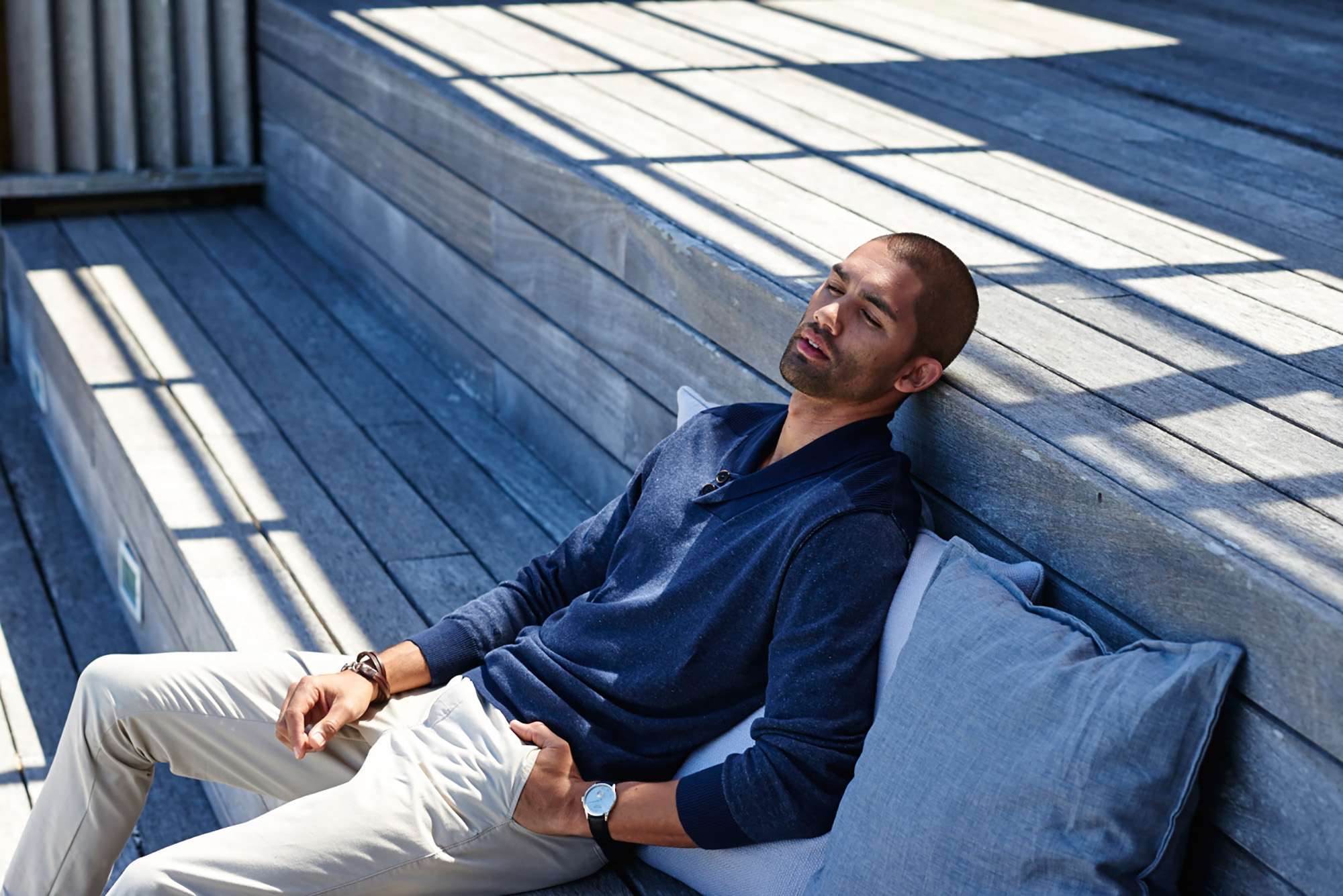 male model blue shirt sit in outdoor