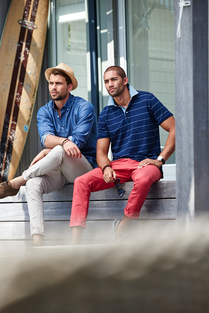 red trousers two male models SIT on outdoor