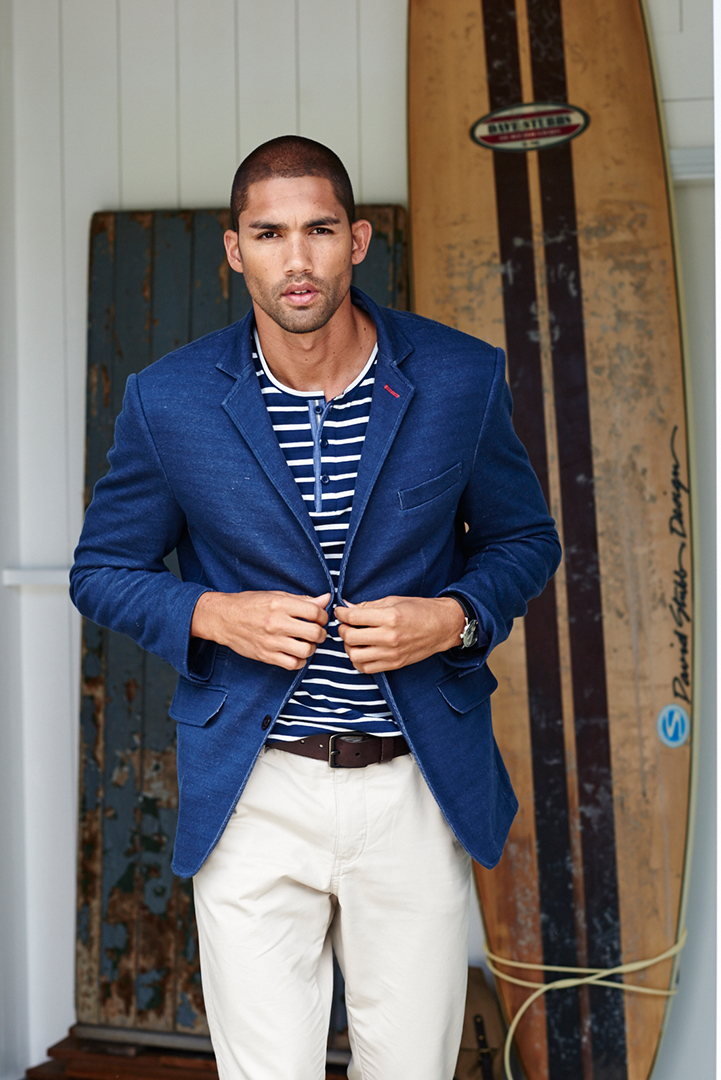 white trousers blue jacket surfboard