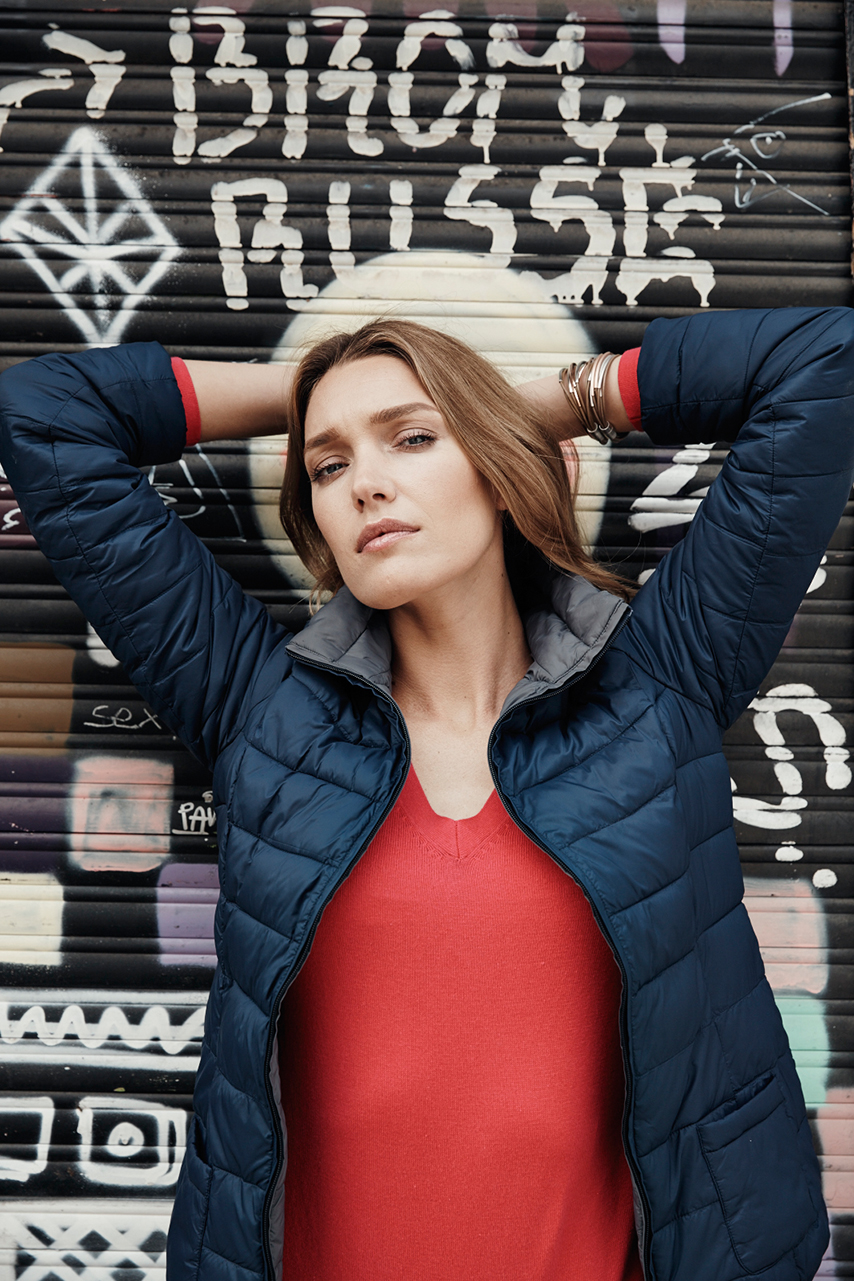 red shirt blue jacket female model outdoor