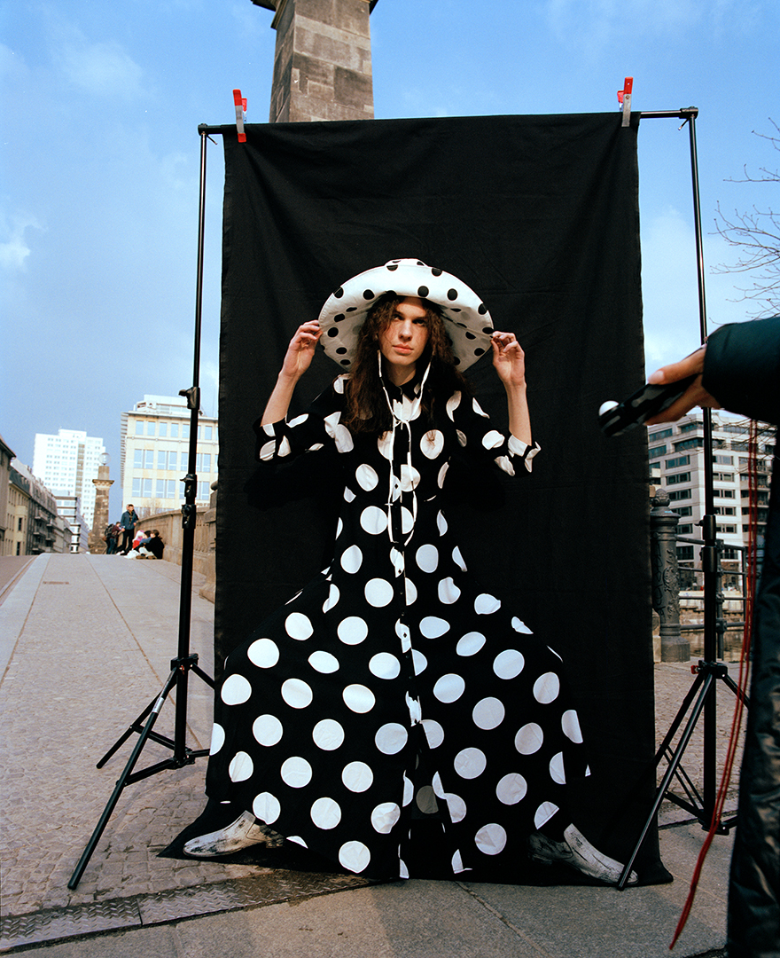 polka dots black and white hat long curly hair male blue sky