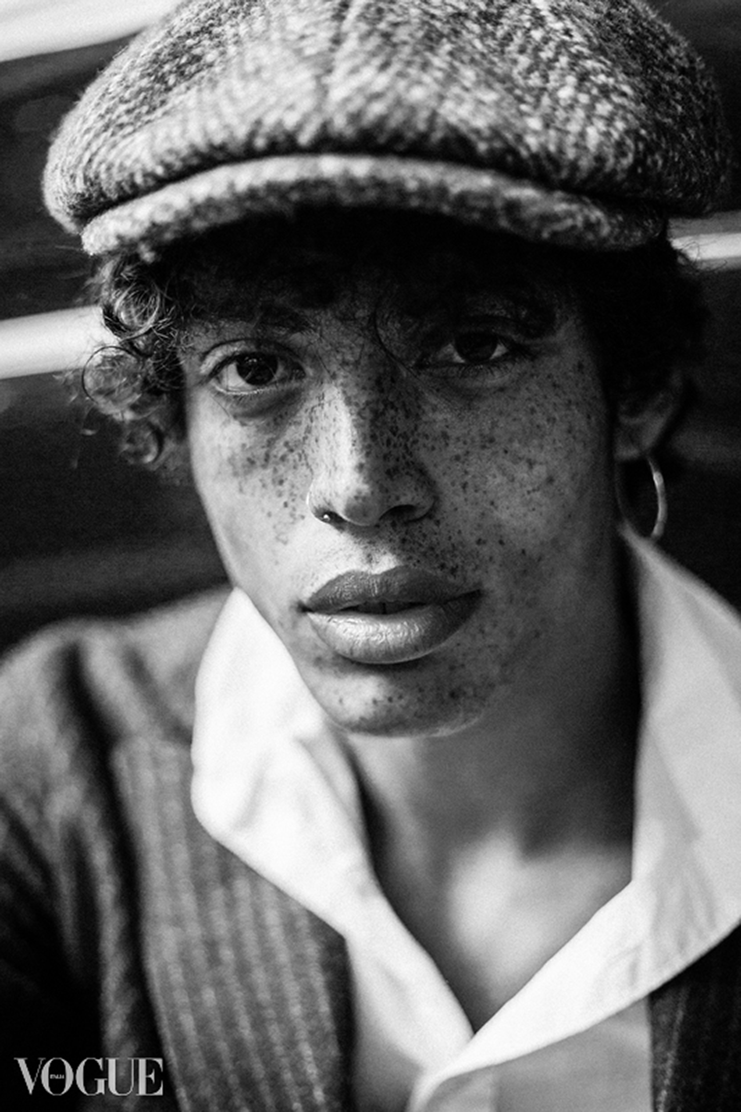 christiano portrait black and white curly hair freckles